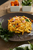 Raw pumpkin noodles with pancetta and cooking cream