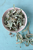 Dried linden flowers for tea in small bowls