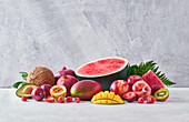 Set of assorted sweet exotic fruits and berries arranged on table