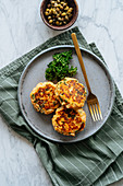 Grilled fish cutlets on metal plate