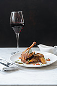 Roasted quail and glass of red wine