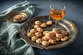 Amaretto liqueur and Amaretto cookies on a dark table