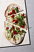 Spelt tarte flambé with mackerel, courgette and goat's cheese