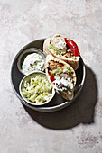 Turkey bifteki in a pita bread with German coleslaw and tzatziki