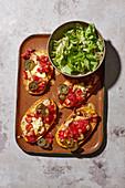 Sweet potato 'toast' with turkey escalope, tomatoes and olives