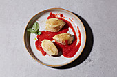 Quark dumplings with strawberry sauce