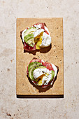 Avocado toast with ham and poached egg