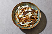 Lentil pasta salad with black salsify and feta cheese