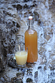 Apple cider vinegar drink in bottle and glass from a natural source