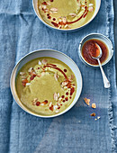 Chickpea and potato soup with almond mousse and harissa oil