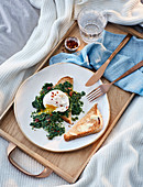 Spinach with poached eggs and toast