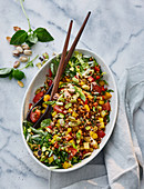 Lentil salad with peppers and pistachios
