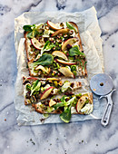Autumnal tarte flambé with apples, leek and hazelnuts