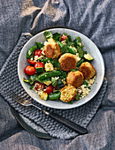 Couscous with vegetables, falafel and sheep's cheese