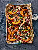 Tray-baked pumpkin with dried fruit and tahini sauce