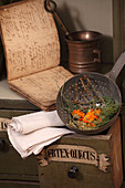 Marigolds and herbs in an antique metal sieve