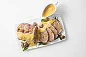 Stuffed pork neck cooked in milk with chestnuts and pistachio nuts