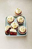 Chocolate cupcakes topped with cream cheese frosting (sugar-free)