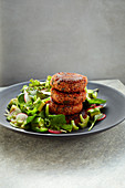 Bean and quinoa fritters with salad and a grapefruit dressing