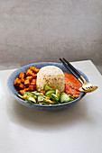'Nasi Campur' – BBQ tempeh with a spicy lentil sambal and cucumber salad