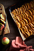 Sliced baked apples on baking tray