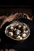 Quail eggs placed in straw
