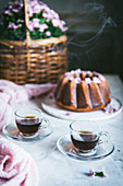 Hot tea in glass cups with Bundt cake