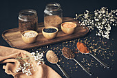 Assorted grains in jars and spices in spoons