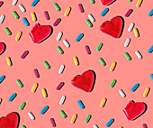 Pattern of heart shaped and colorful small jelly candies