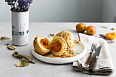 Apricot dumplings with buttered crumbs