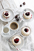 Mini meringues with cream and cherries