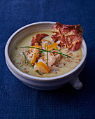 Pea soup with haddock and crispy bacon