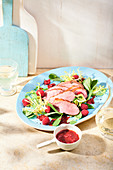 Duck breast with purslane and raspberry dressing