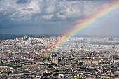Notre Dame de Paris cathedral under a rainbow