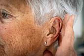 Woman touching with earache