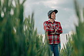 Wheat farmer standing in field