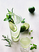Cucumber cocktails with lime and herbs