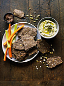 Flax seed crackers with hummus and fresh vegetables