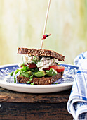 Chicken salad on toast with tomatoes, avocado and mustard