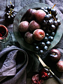 Purple fruit sill - black grapes and plums