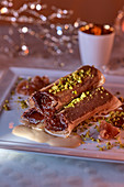 Filo rolls with chocolate cream and pistachios