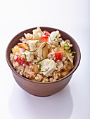 Quinoa salad with goat's cheese, vegetables and almonds