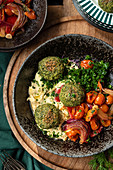 Vegetarian hummus and falafel served with vegetables and green herbs