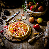 French apple pie in the making with eating apples