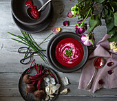 Beetroot soup with sour cream and chiives