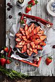 Strawberry tart on wooden tray