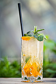 'Orange Fizzy' with gin, almond syrup, lime juice, kumquats and mint