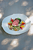 Poached saddle of venison with a trio of chard