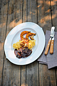 Wild hare stew with grilled pumpkin wedges and tagliatelle