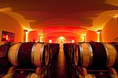 Barrel cellar, Chateau Angelus, Saint-Emilion, Bordeaux, France